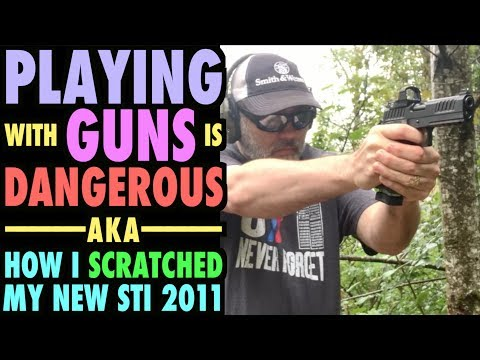 Playing with Guns is DANGEROUS!...(How I scratched my STI)